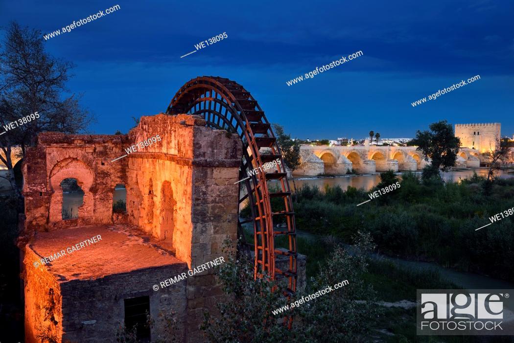 Stock Photo: Lights on Albolafia Waterwheel at dusk on the Guadalquivir river with Roman Bridge and Calahorra Tower Cordoba.