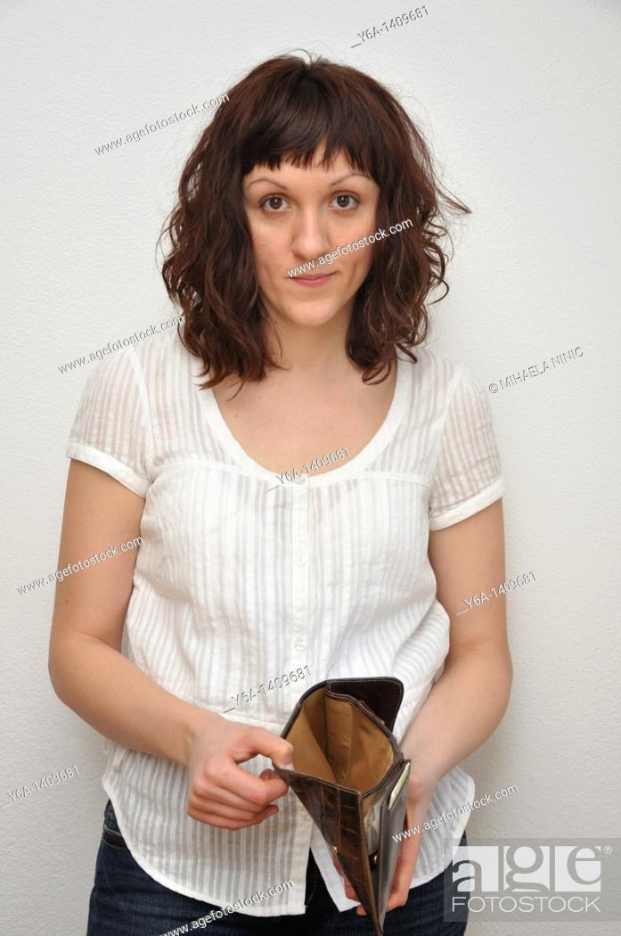 Stock Photo: Woman holding empty wallet.