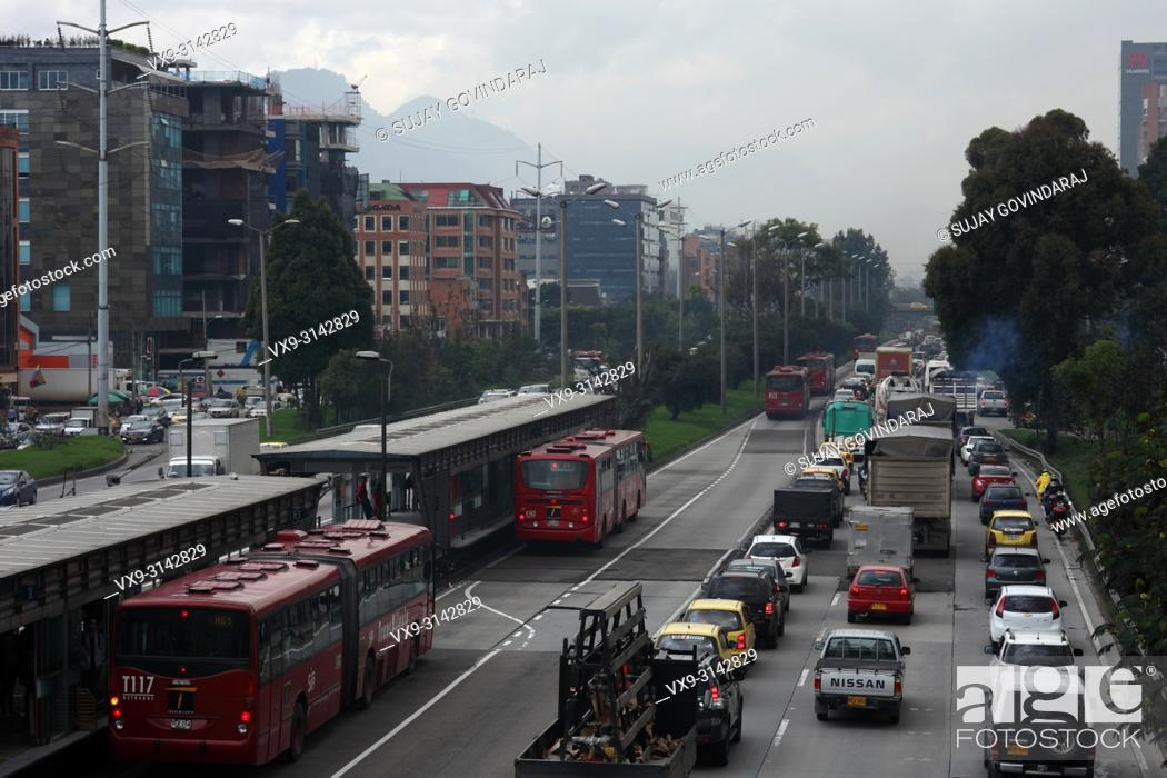 Stock Photo: Bogota, Colombia. The traffic on the Southbound carriageway is virtually bumper to bumper. To the left is the TransMilenio station called Calle 127.