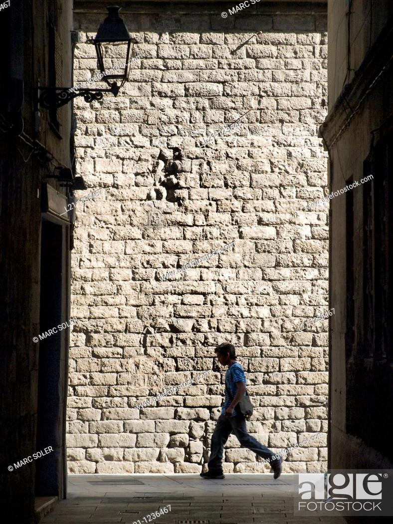 Stock Photo: Silhouette of a man passing by the Church of Santa Maria del Mar, Ciutat Vella district, Barcelona, Catalonia, Spain.