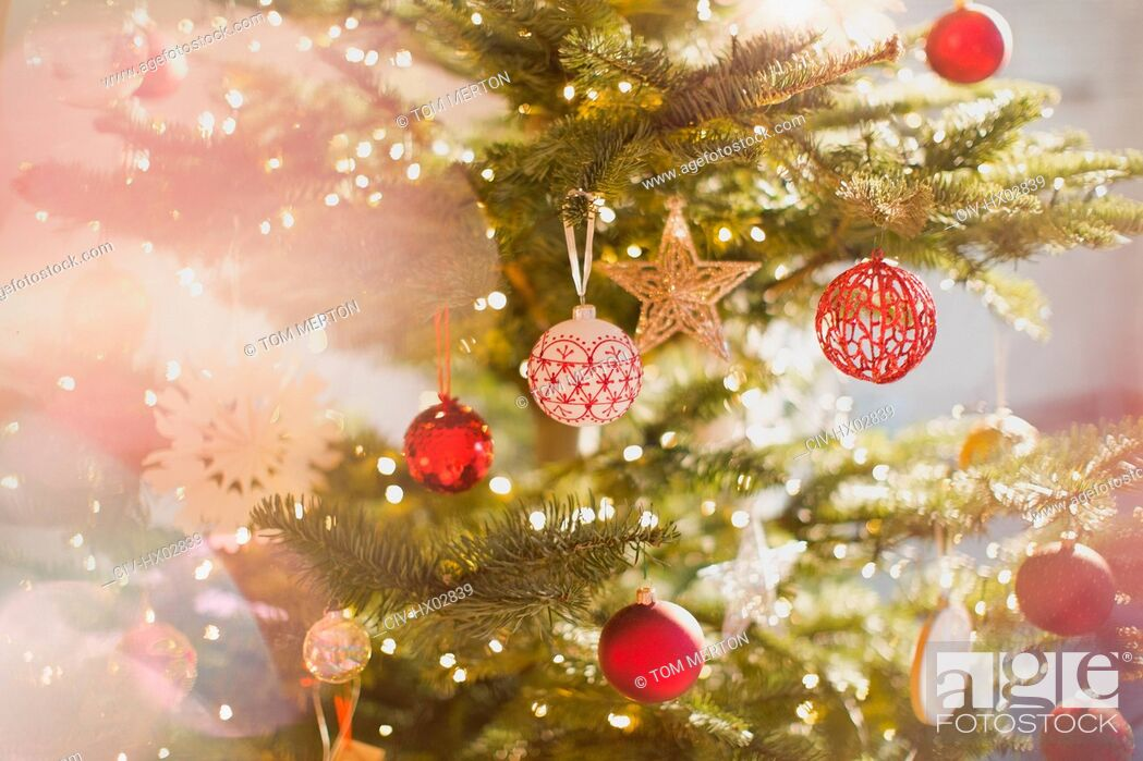 Stock Photo: Red, white and gold ornaments and star on Christmas tree.