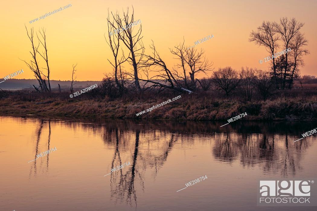 Stock Photo: Sunset over Bug river near Szumin village, Mazowsze region of Poland.