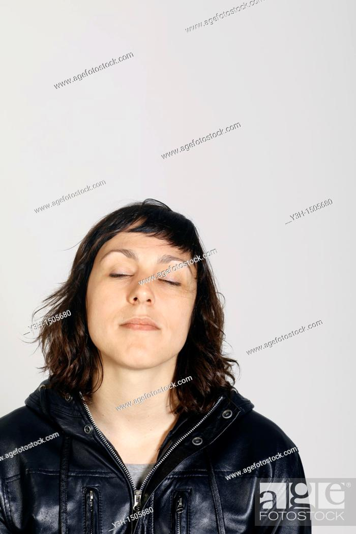 Stock Photo: Studio shot of woman, eyes closed.