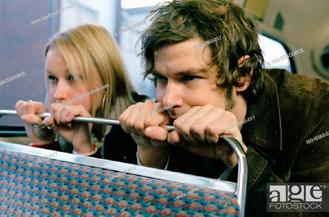 Stock Photo: Couple sitting on bus.