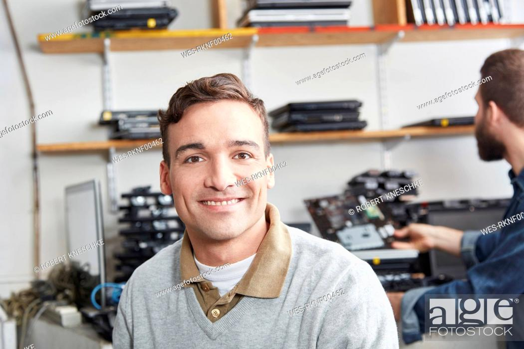 Stock Photo: Portrait of a man working in a computer recycling plant.