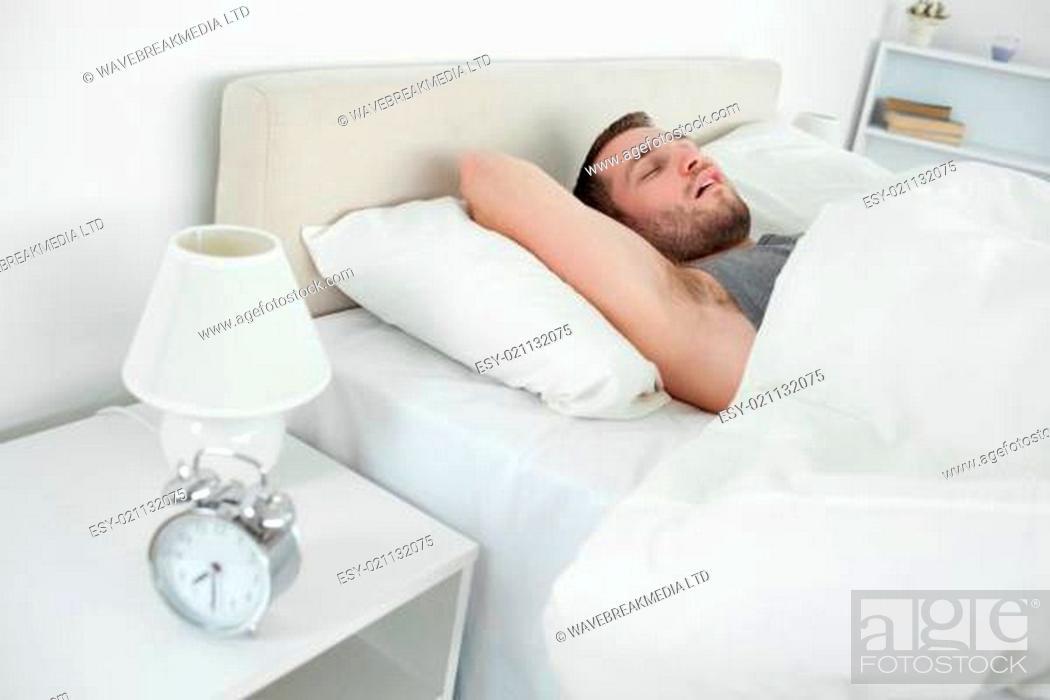 Stock Photo: Tired man sleeping.