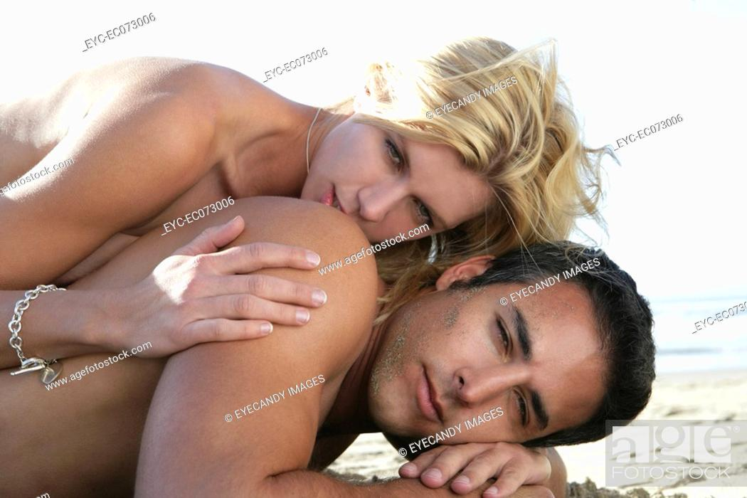 Stock Photo: Sexy nude couple laying on beach.