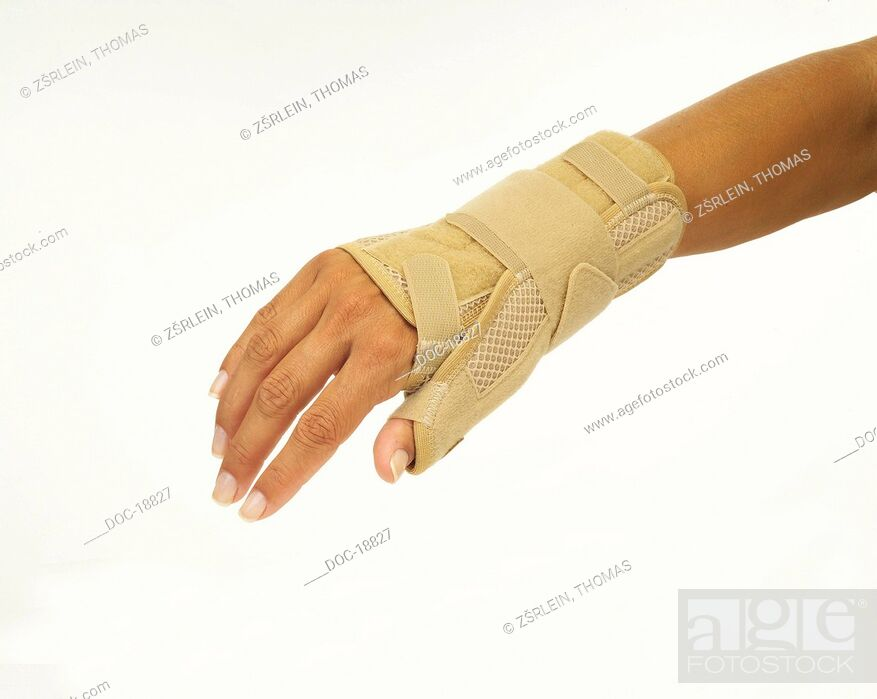Stock Photo: woman's wrist with orthosis.
