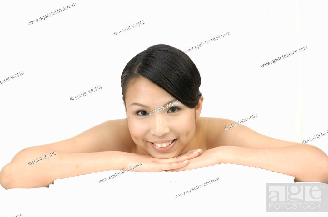 Stock Photo: Close-up of a woman smiling in spa.