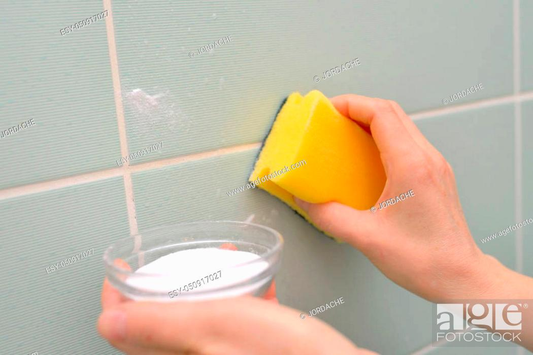 Stock Photo: Clean faience with baking soda and sponge.