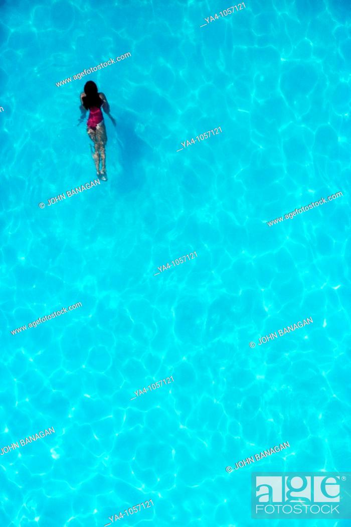 Stock Photo: Girl swimming in pool.