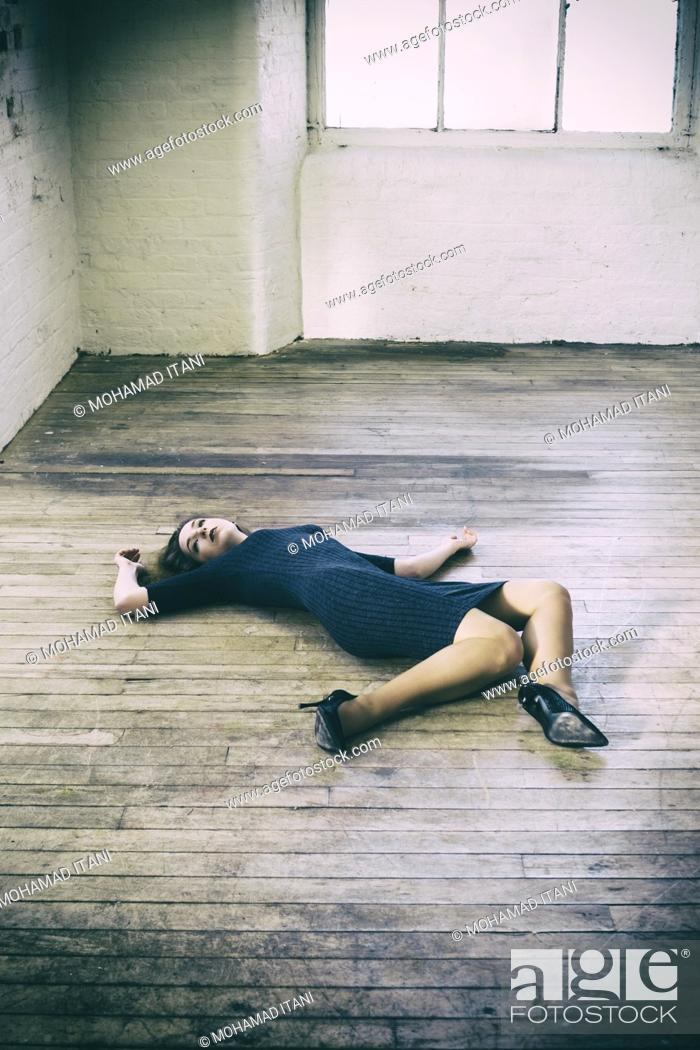 Stock Photo: Dead woman laying down on the floor.