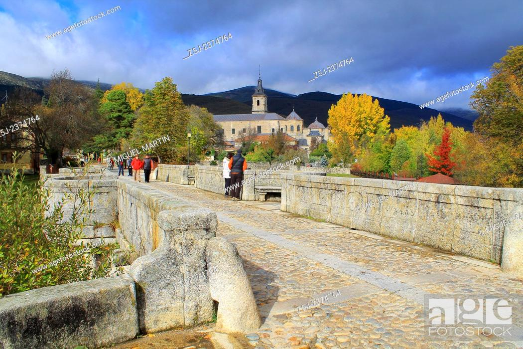 Stock Photo: View over the monastery of El Paular from the Puente del Perdón (Bridge of the Pardon) in a cold Autumn morning; this bridge was the last point where convicted.