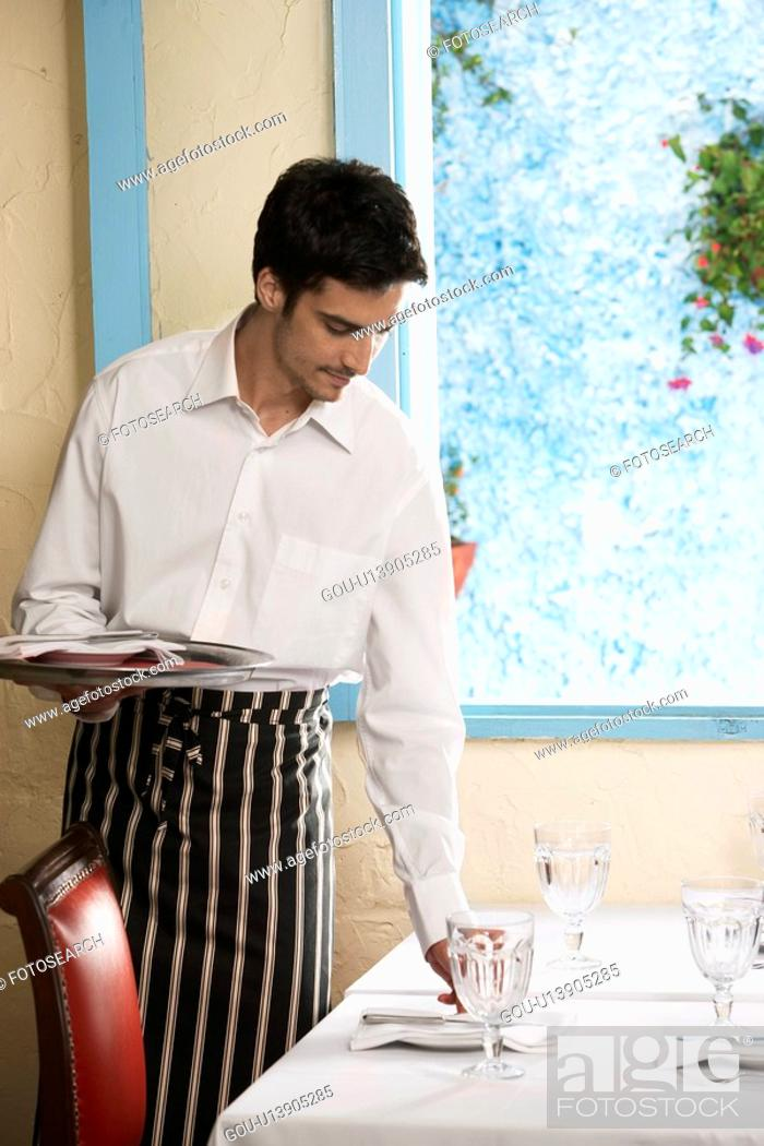 Stock Photo: Waiter laying table.
