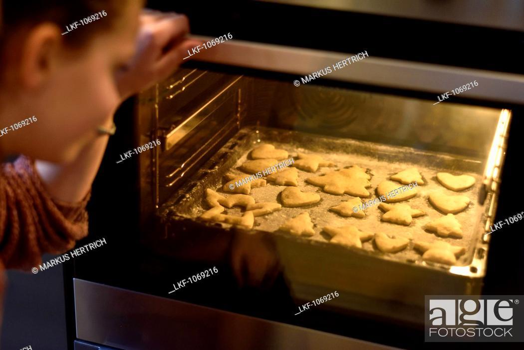 Stock Photo: 11 years old girls baking christmas cookies, Hamburg, Germany.