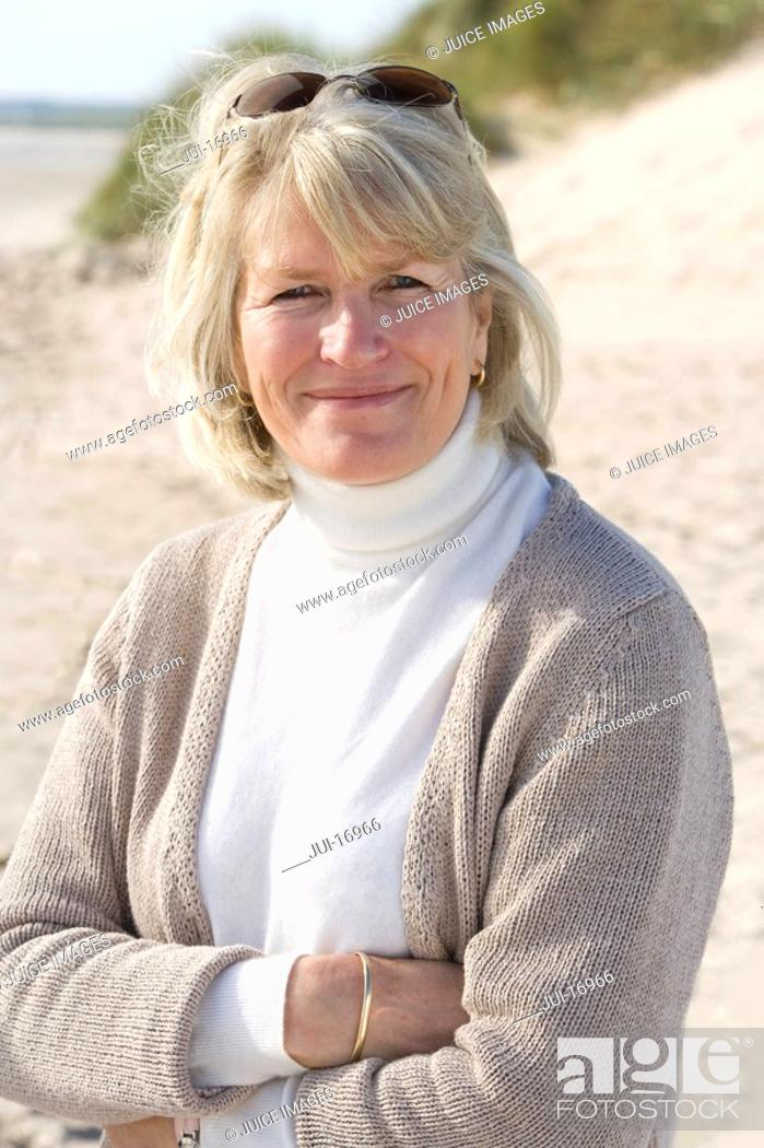 Stock Photo: Portrait of mature woman standing on beach.