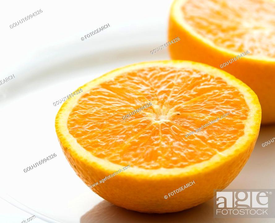Stock Photo: Halved orange against white background.