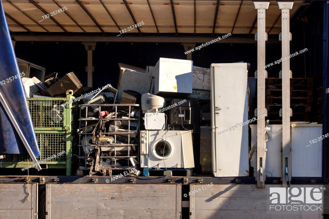 Stock Photo: warehouse full of appliances and other items for recycling.