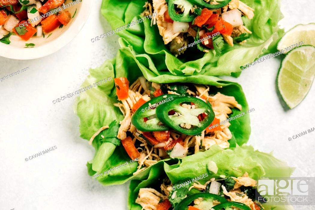 Stock Photo: Cilantro lime chicken lettuce wrapped tacos.
