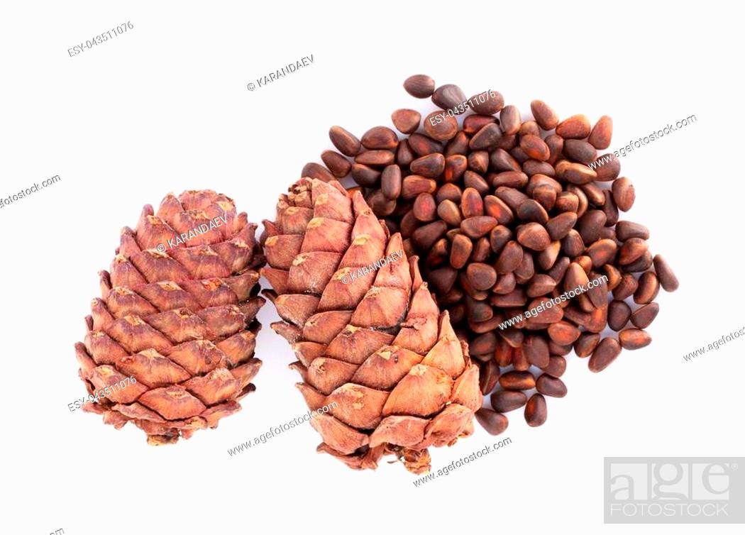 Stock Photo: Pine nuts. Isolated on white background.