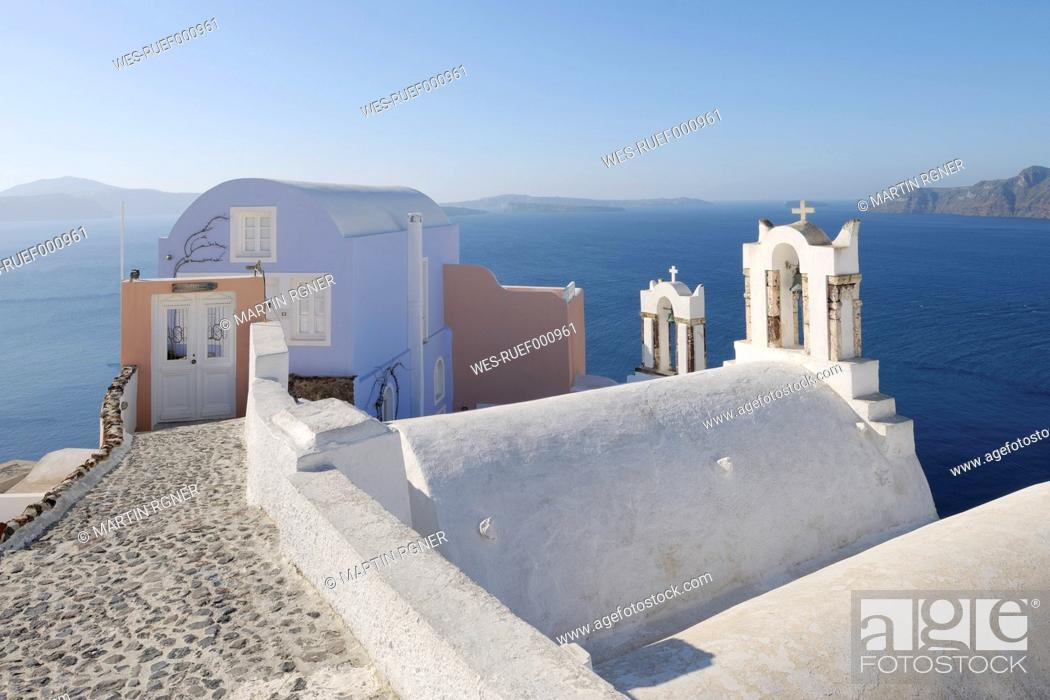 Stock Photo: Greece, View of Oia village with bell tower of Greek Orthodox Church at Santorini.