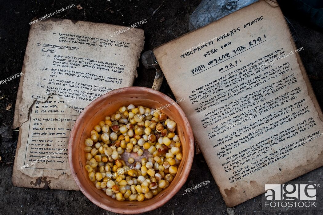 Stock Photo: Orthodox christian book + morning meal ( i. e. corn grains). Photo taken outside the hut of a blacksmith family living near Korem ( Tigray state, Ethiopia).