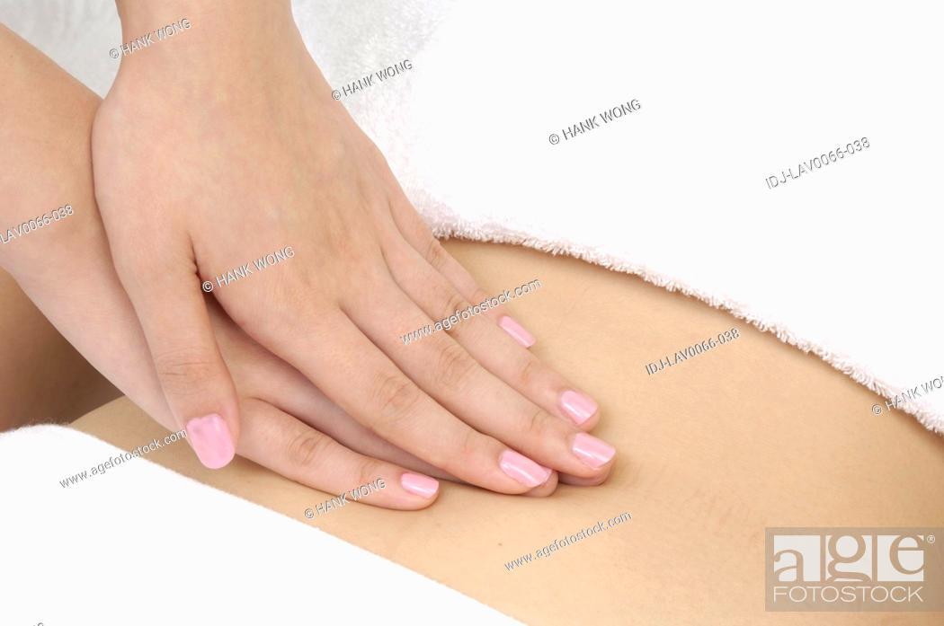 Stock Photo: Woman getting stomach massage.