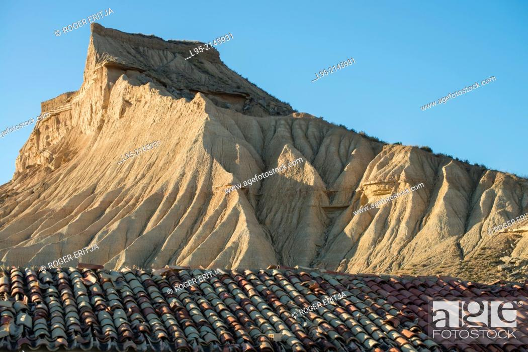 Stock Photo: Cliffs eroded by rainfall juxtaposed to ruined traditional cattle shelter on clay-only area of the natural park of Bardenas Reales de Navarra, Navarre, Spain.
