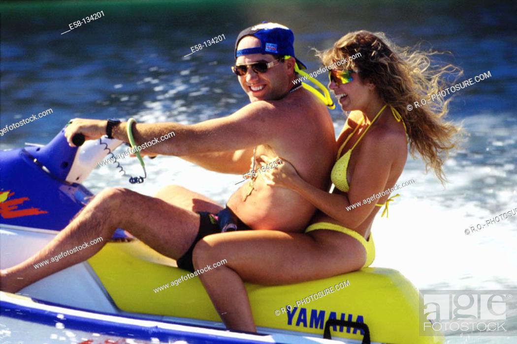 Stock Photo: Couple on jet ski.