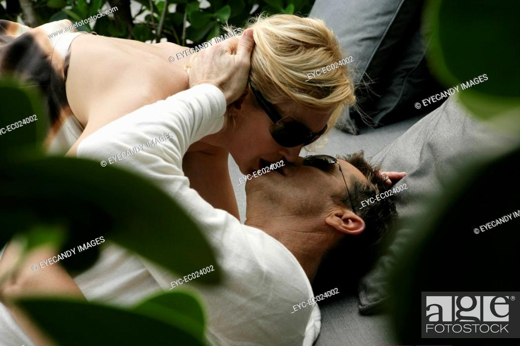 Stock Photo: View of a couple kissing.