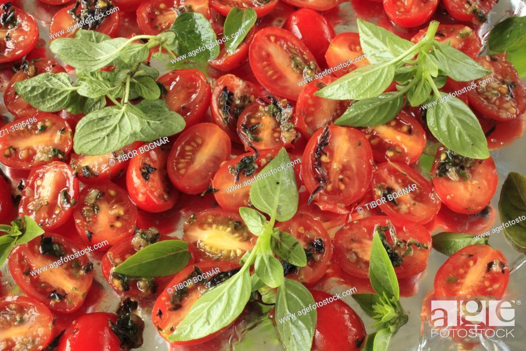 Stock Photo: Cherry tomatoes with basilic, .