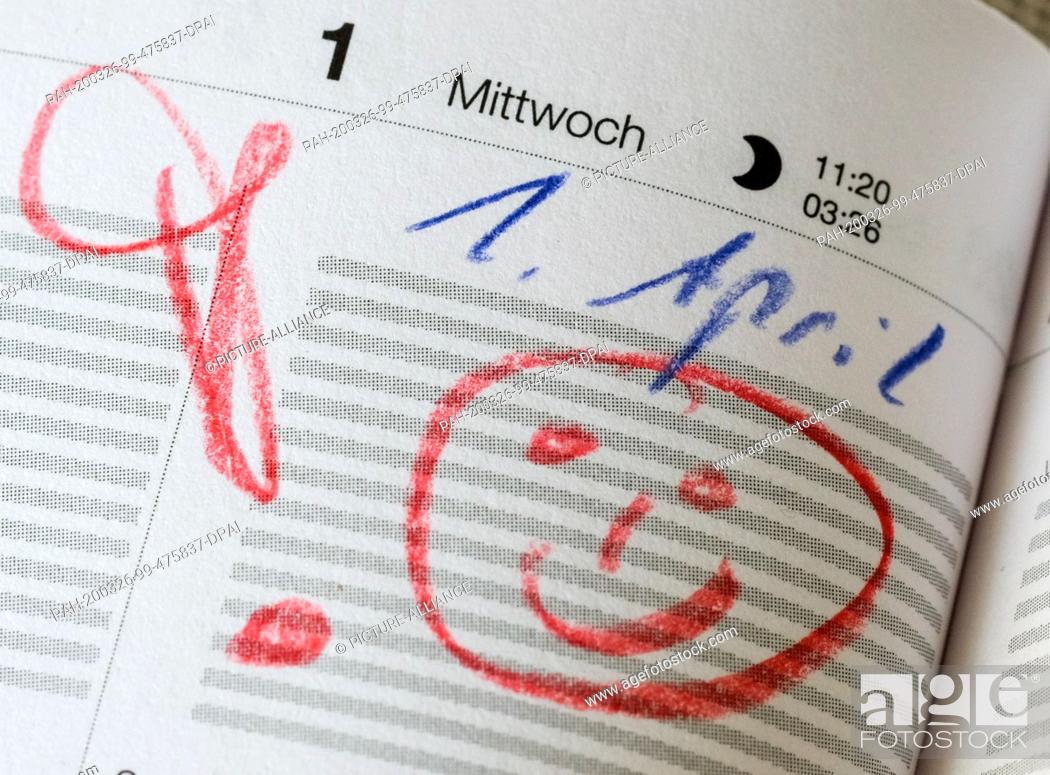 """Stock Photo: 24 March 2020, Berlin: In a calendar on April 1st there is a warning exclamation mark and a smiley. (Illustration for dpa-Korr """"""""April."""