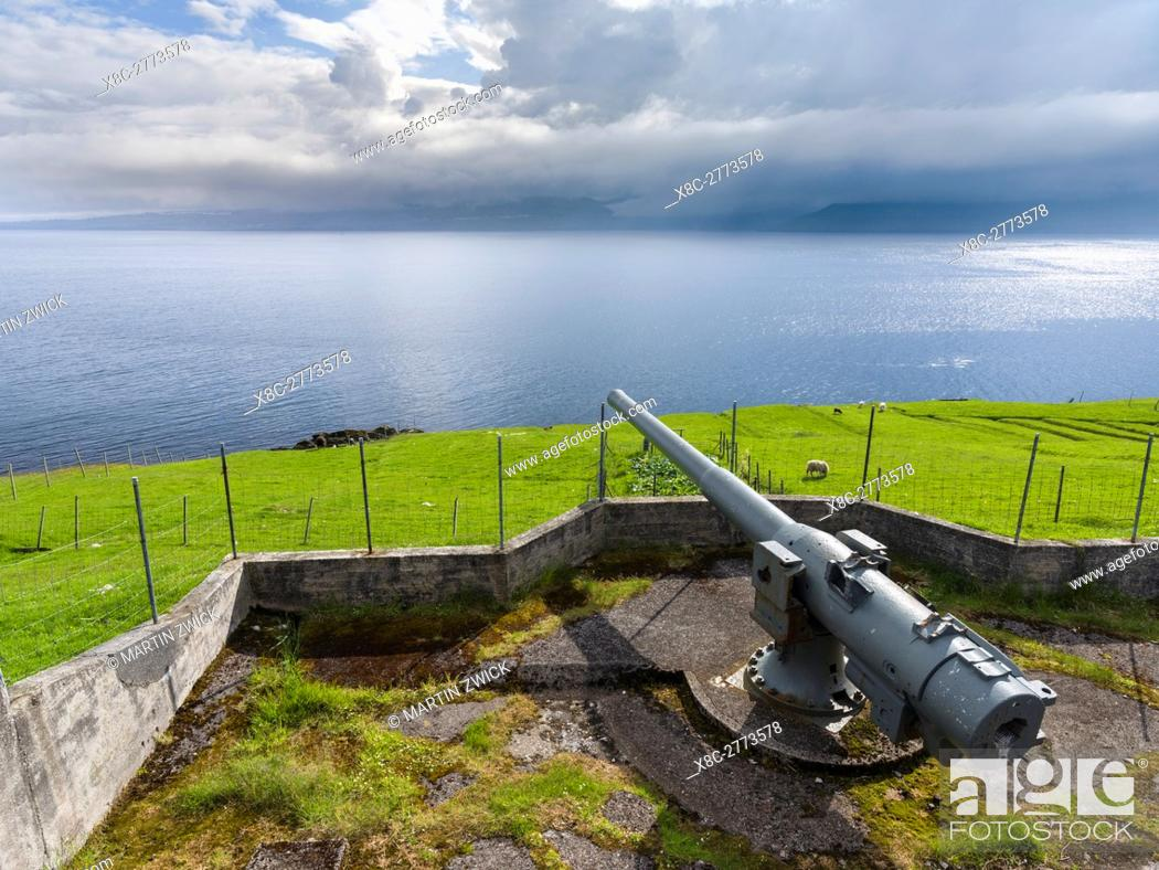 Stock Photo: Cannon in the village Nes dating back to the second world war, now a historic monument. The island Eysturoy one of the two large islands of the Faroe Islands in.