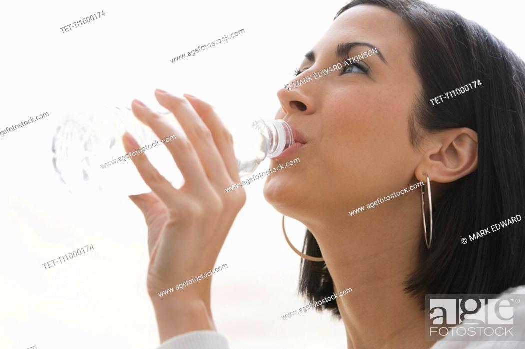 Stock Photo: Woman drinking water.