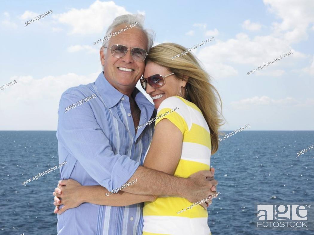 Stock Photo: Middle-aged couple embracing against sea portrait.