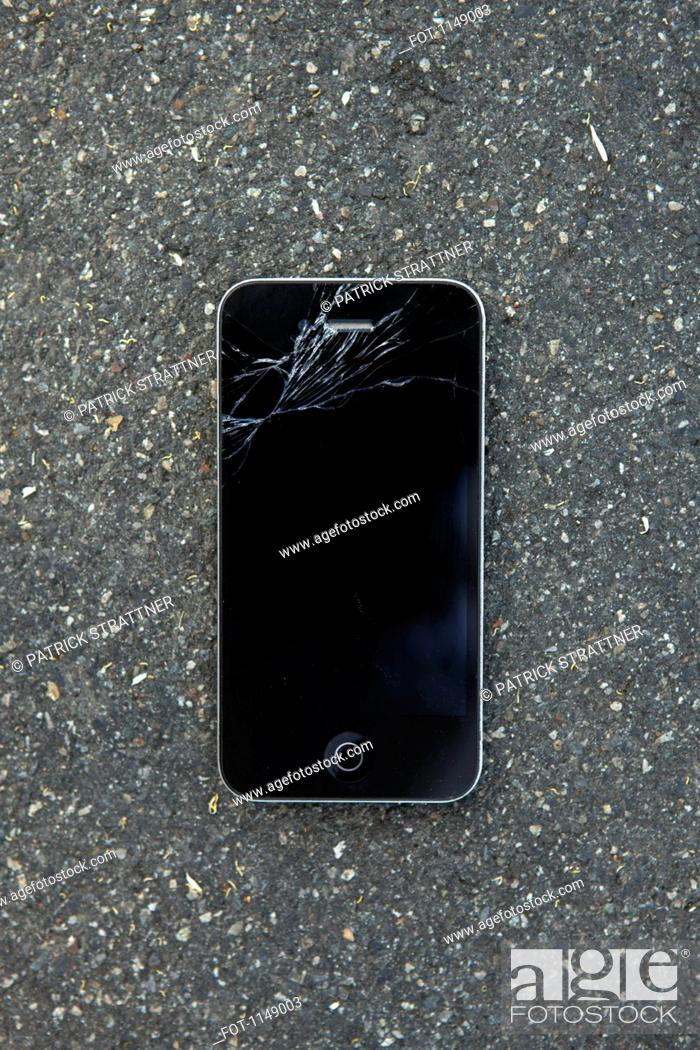 Stock Photo: A smart phone with a cracked screen.