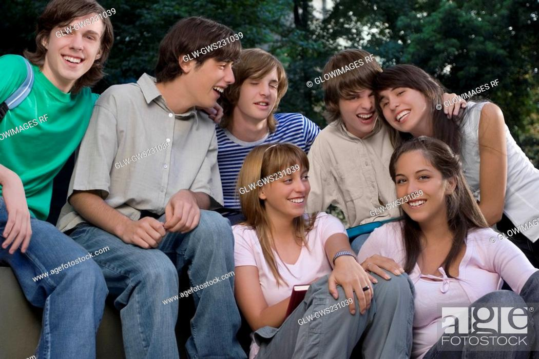 Stock Photo: School friends smiling together.