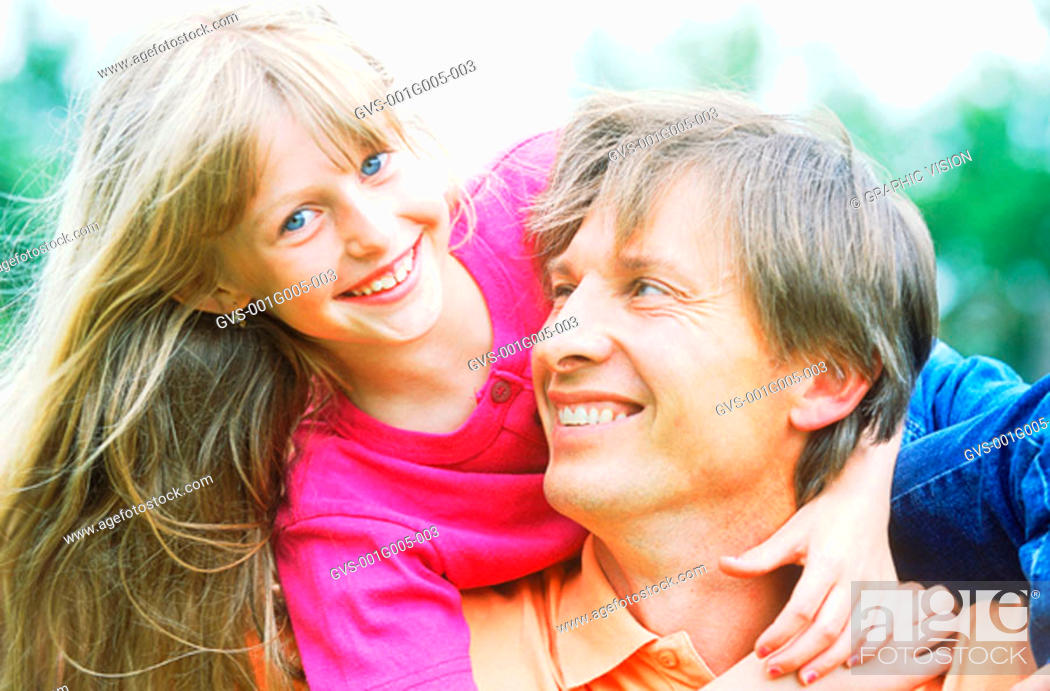 Stock Photo: Father carrying daughter on his shoulder.