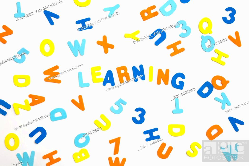 Stock Photo: Colorful letters and the word learning on white background, learning or study concept various colors.