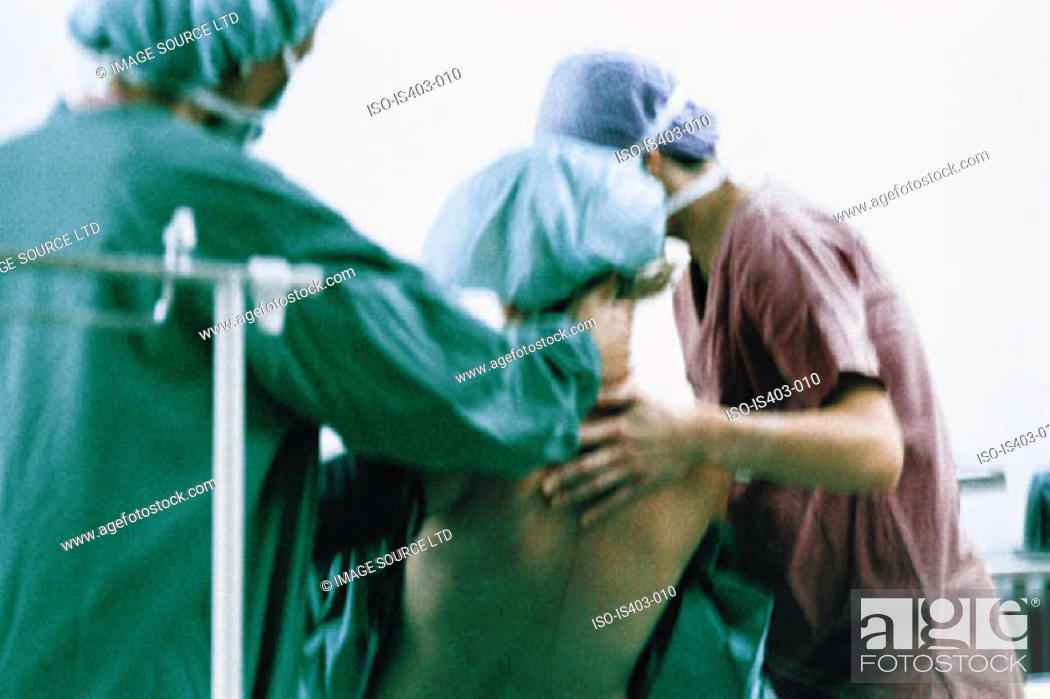 Stock Photo: Surgeons supporting patient.