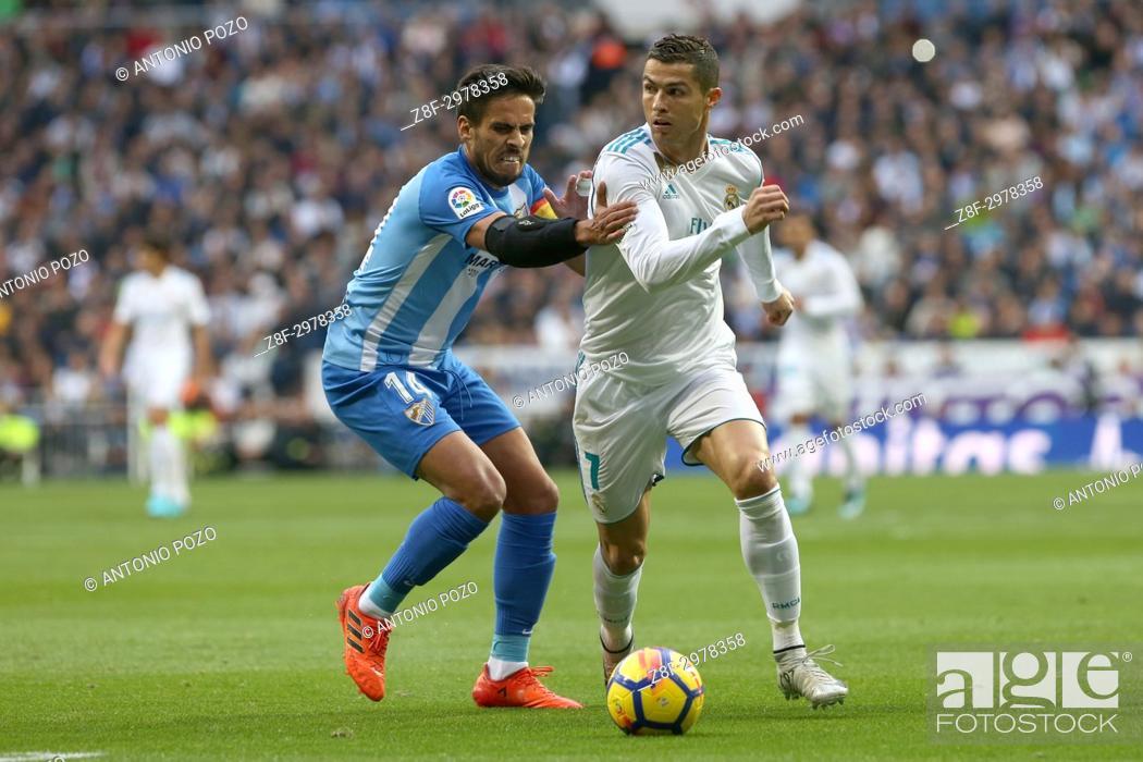 Stock Photo: MADRID, SPAIN. November 25, 2017 - Recio and Cristiano Ronaldo. Real Madrid have chalked up an important victory, 3-2, against Málaga at the Bernabéu.