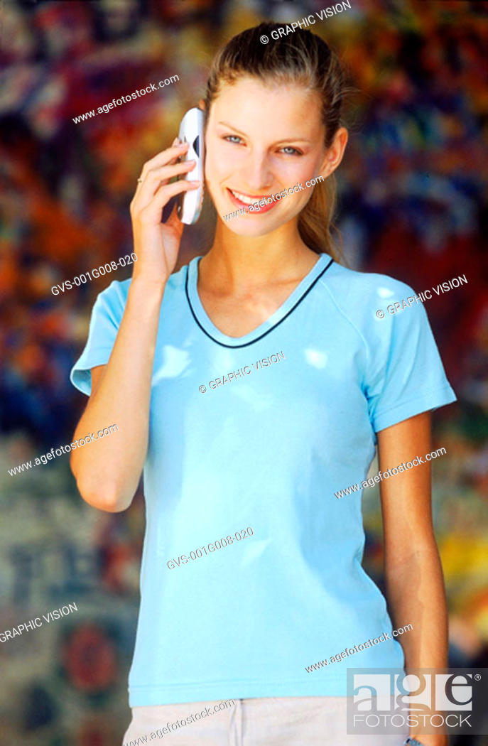 Stock Photo: Young woman using a mobile phone.