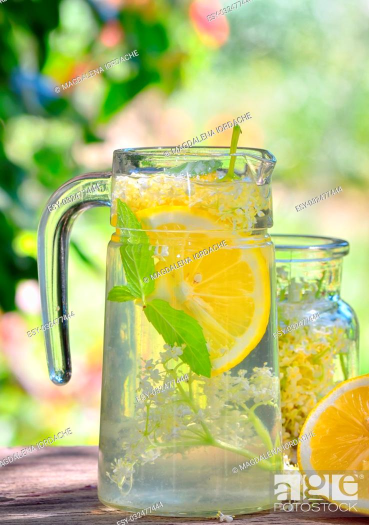Stock Photo: Elder lemonade with lemon on old table wood.