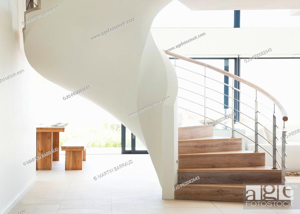 Stock Photo: Curving staircase in modern home.