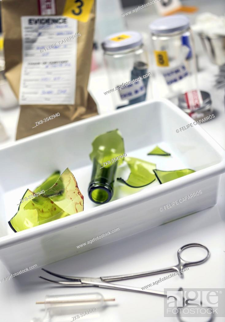 Stock Photo: broken glass bottle in Criminalistic Lab, conceptual image.