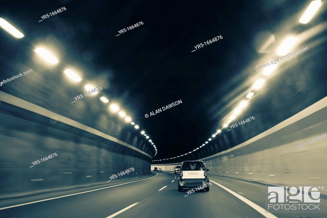 Stock Photo: Cars approaching tunnel exit.