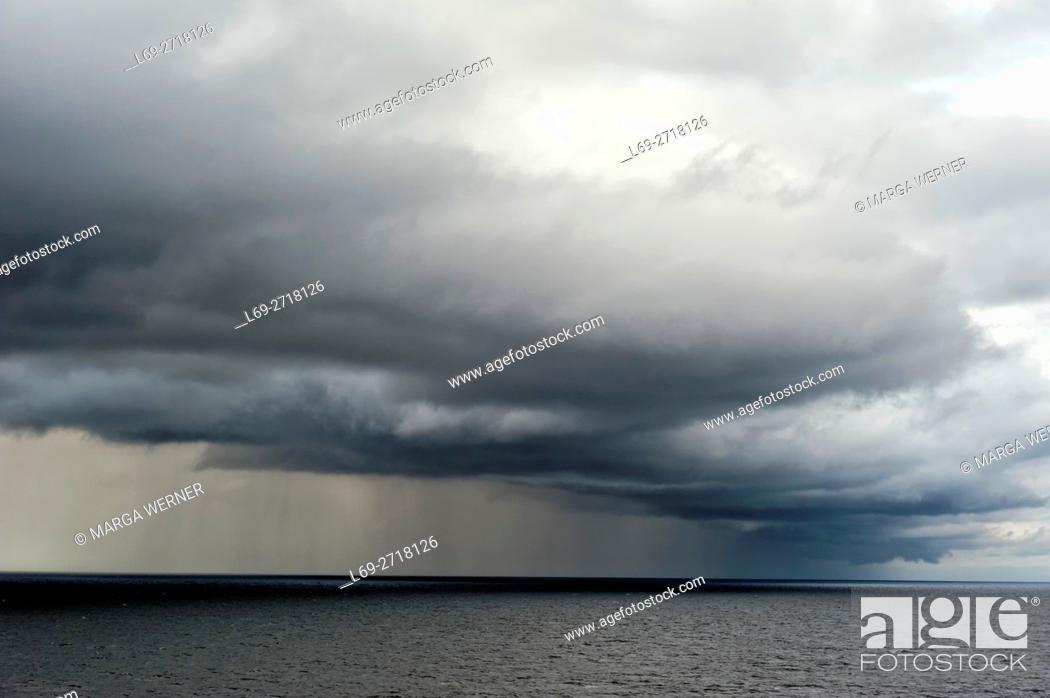 Stock Photo: Rain clouds over Baltic Sea, Europe.