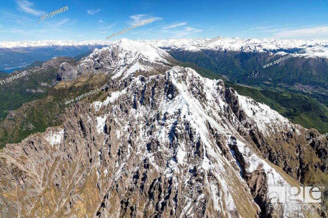 Stock Photo: Aerial view of the snowy ridges of Grignetta and Grignone mountains in spring Lecco Province Lombardy Italy Europe.
