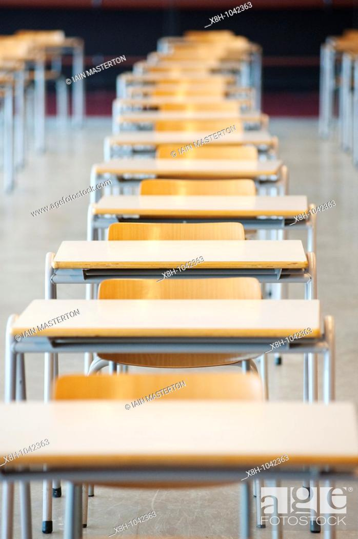 Stock Photo: Many tables and chairs inside examination hall at university.