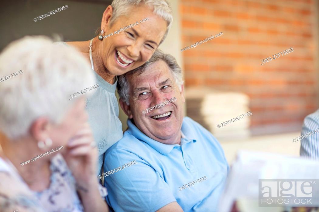Stock Photo: Portait of smiling senior man having fun with his friends.